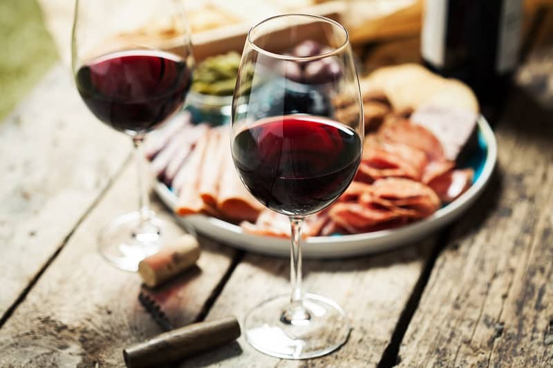 Red,Wine,With,Charcuterie,Assortment,On,The,Background