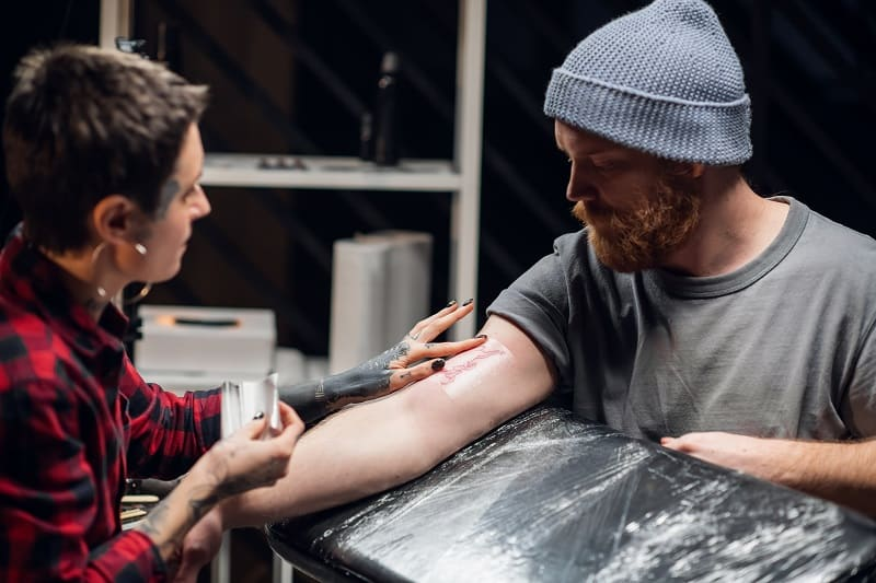Removing your bandage – How Often Should You Wash A New Tattoo