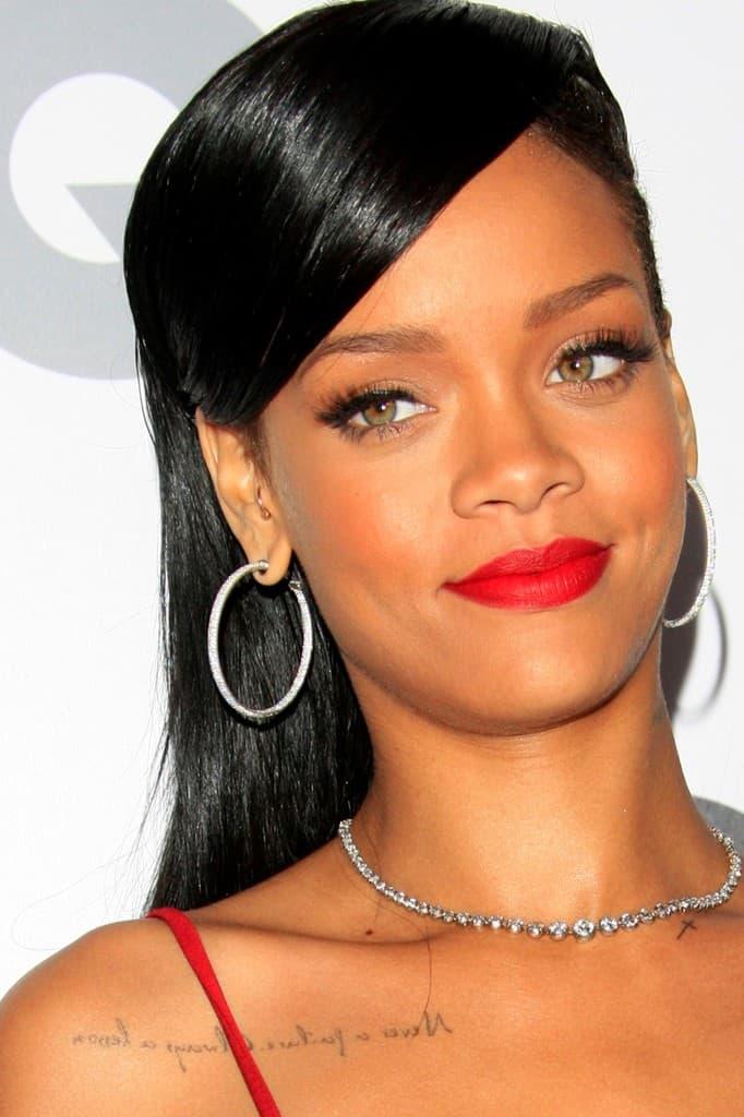 Rihanna Collarbone Tattoo Flowing Script