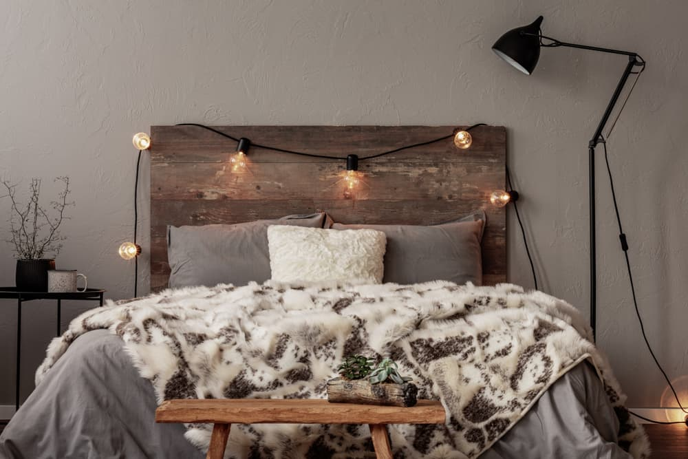 Light,Bulbs,On,Wooden,Headboard,Of,Comfortable,Bed,With,Grey