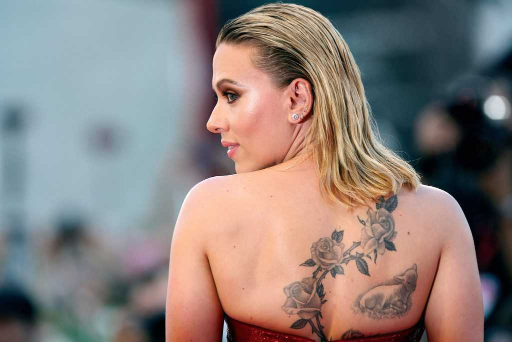 Scarlett Johansson Lamb And Flowers Back Tattoo
