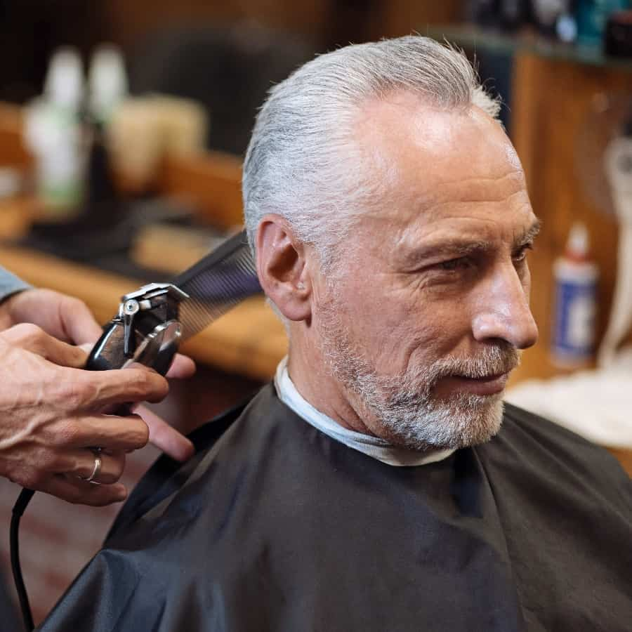 Senior Man At Barbers Getting Pompadour Hairstyle