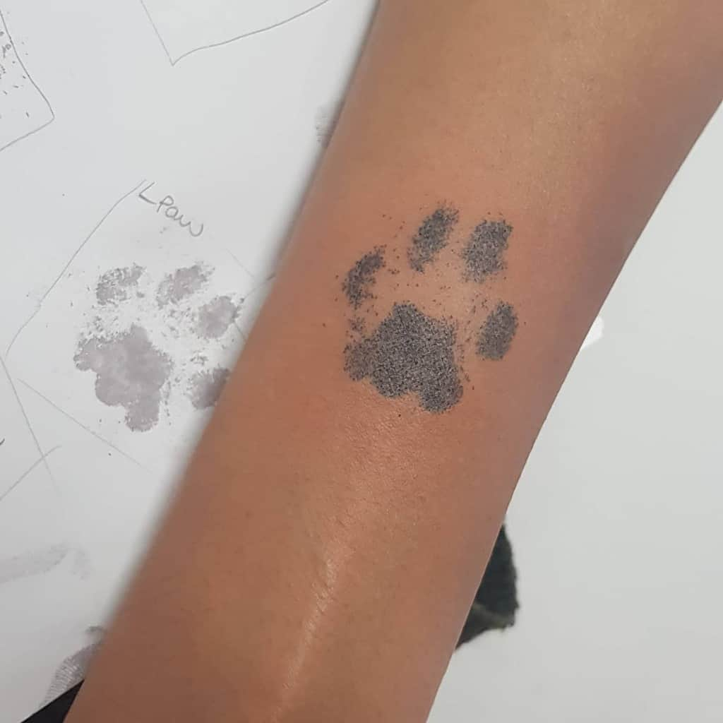 Shaded Cat Paw Print Tattoo handpoked_gelfwai