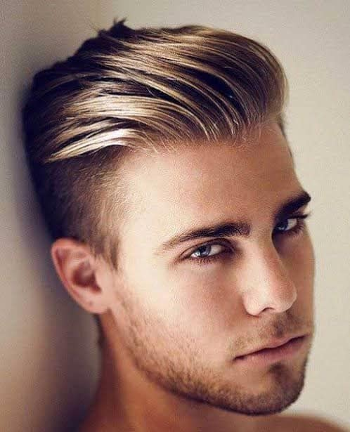 man with sharp slicked back fohawk hairstyle