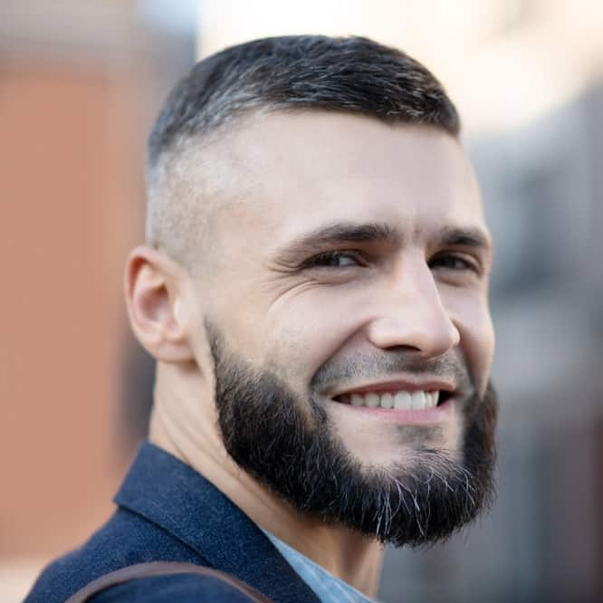 Man With Short Fade Hairstyle With Distinctive Part