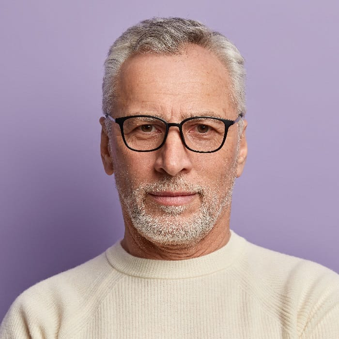 Man With Short Gray Hair, Glasses And Beard