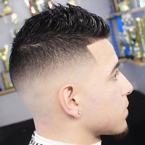 man with short fohawk hairstyle