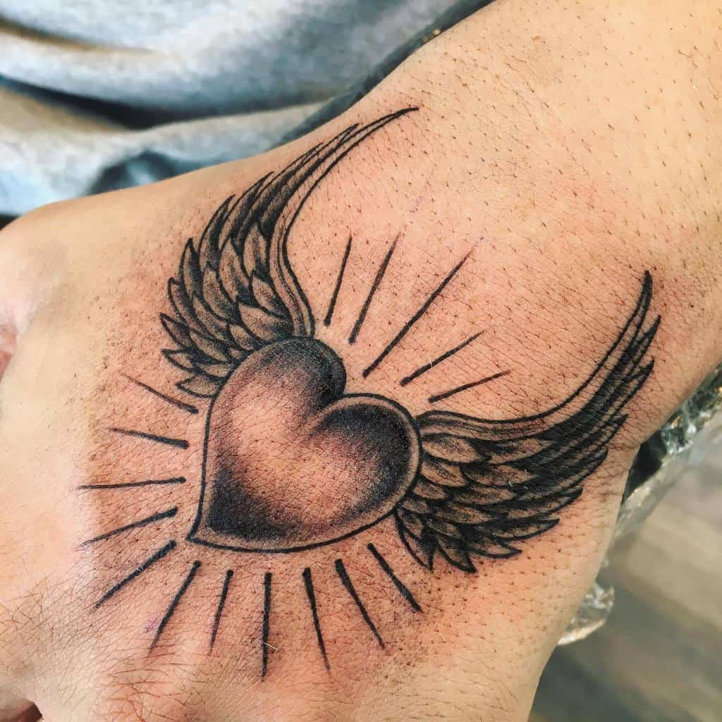Smal Heart With Wings Tattoo shameless_tattoo_merate