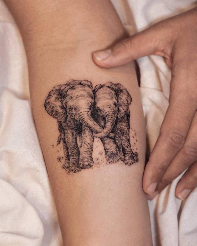 Small Black Elephant Tattoo Heize.latte