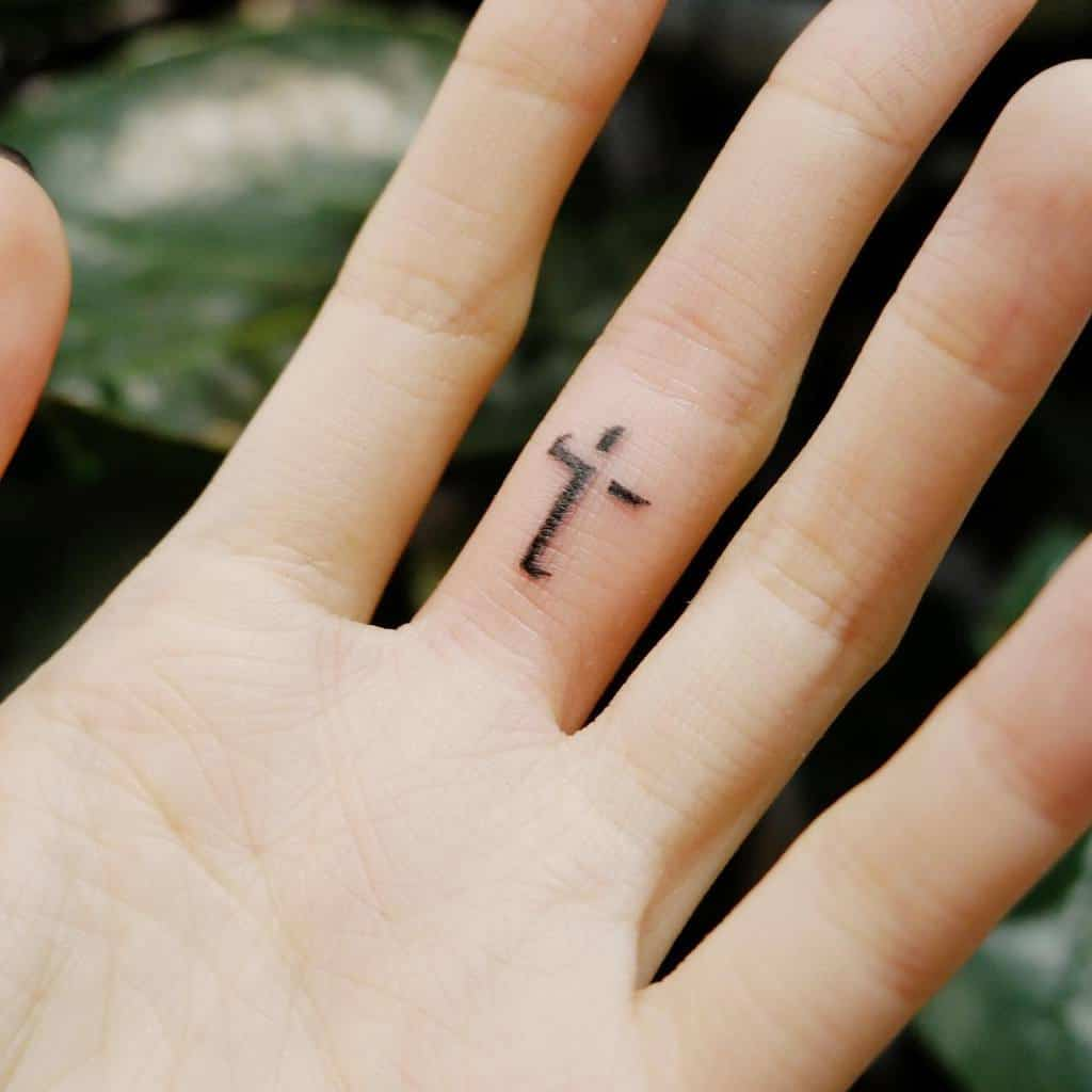 Small Cross Hand Finger Tattoo Ching.tattoo