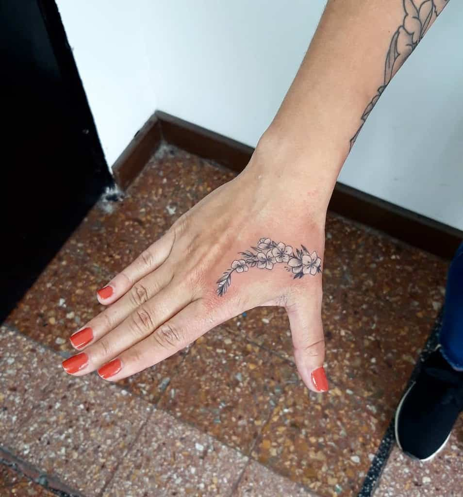 Small Flower Hand Finger Tattoos Cristianprocotattoo