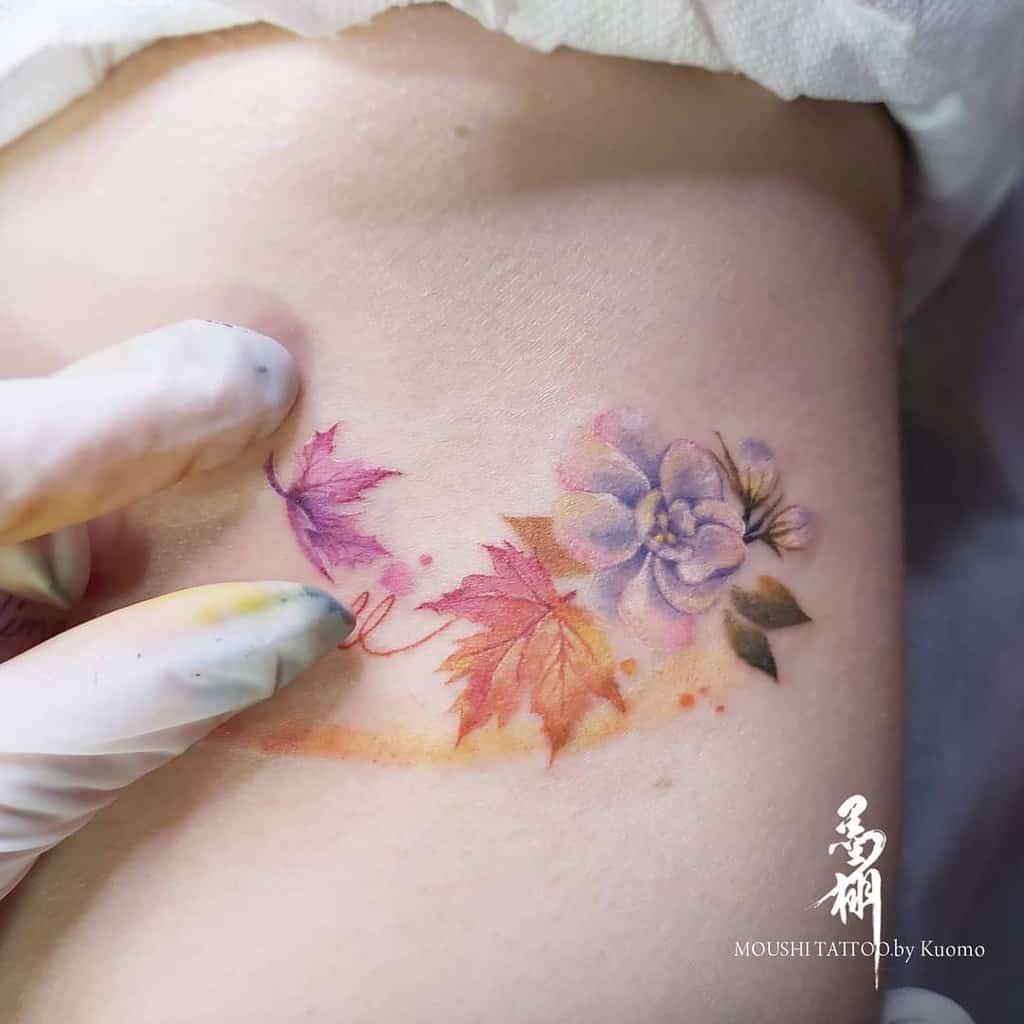 Small Flower Rib Tattoos Wowwow019
