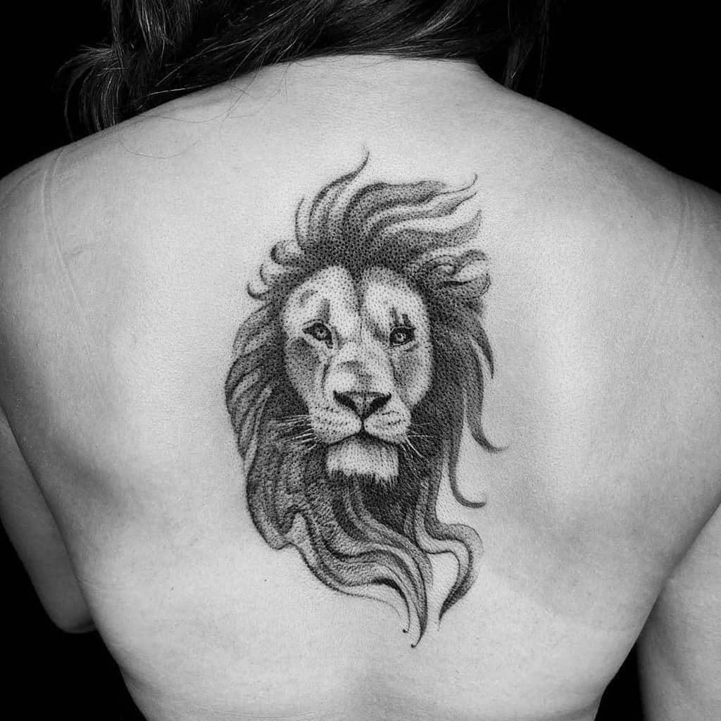 Small Lion Back Tattoos mr.inkwells