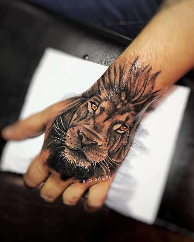 Small Lion Hand Finger Tattoos biojosec