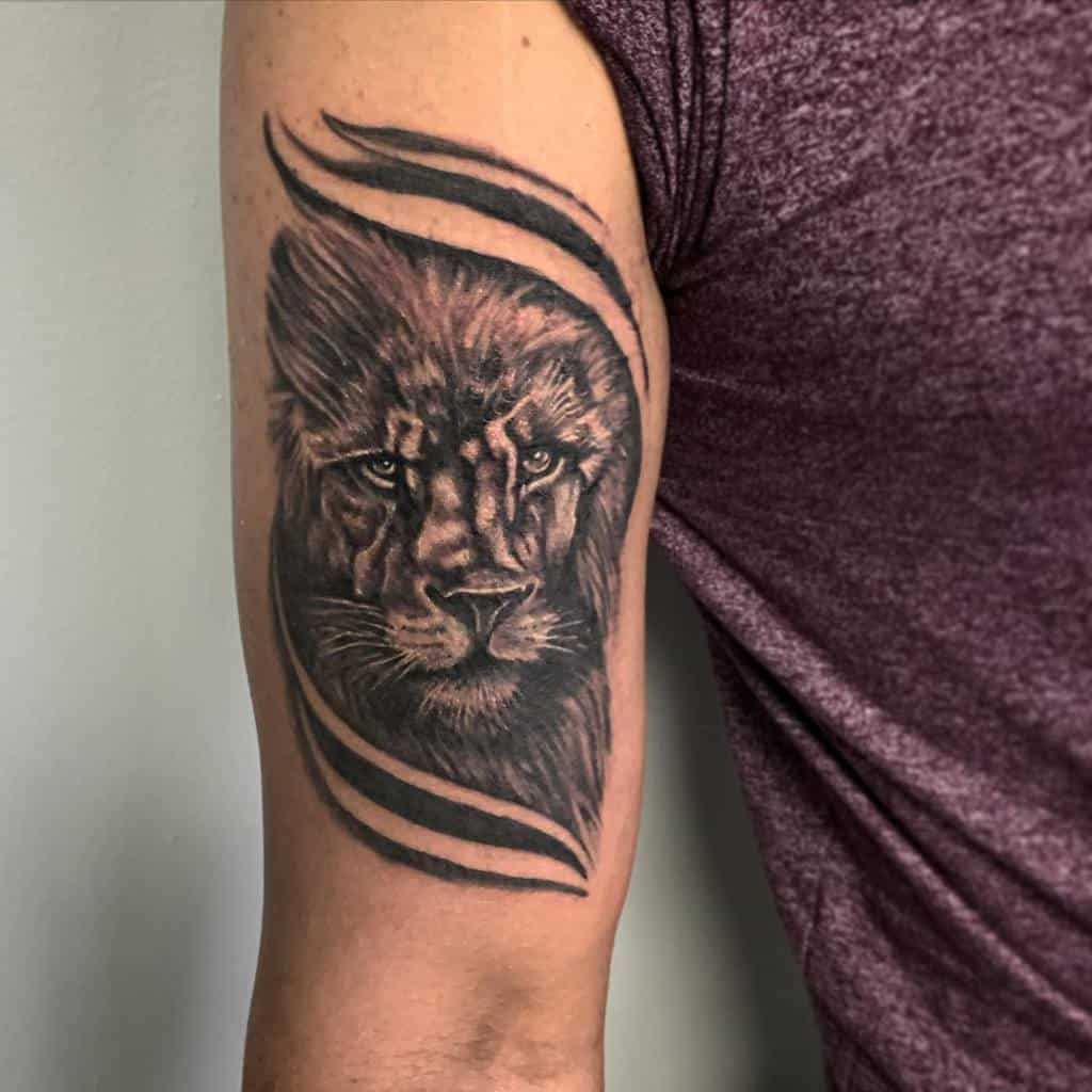 Small Lion Upperarm Tattoos inkcapsandgrommets