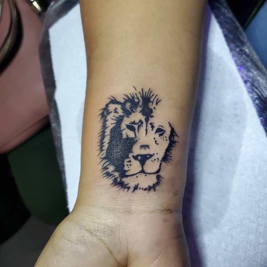 Small Lion Wrist Tattoos danny_tattoos
