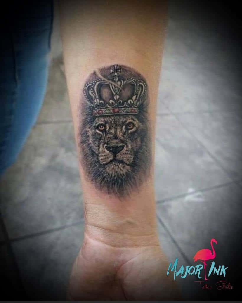 Small Lion Wrist Tattoos major_ink_studios