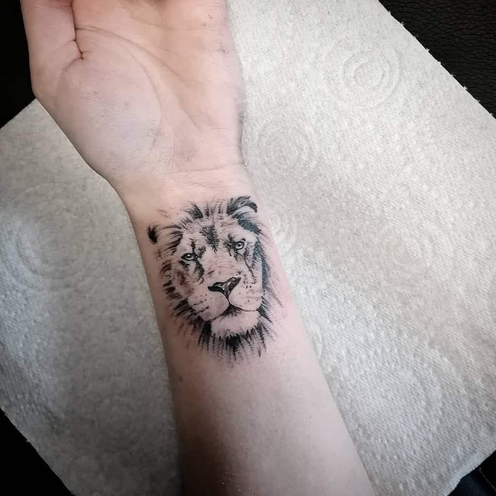Small Lion Wrist Tattoos shaun_tattooartist