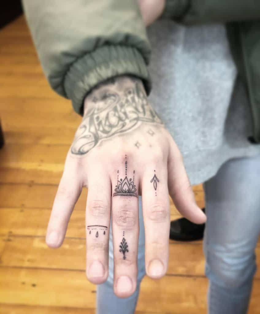 Small Mandala Ornament Finger Tattoos janetattoo_nz