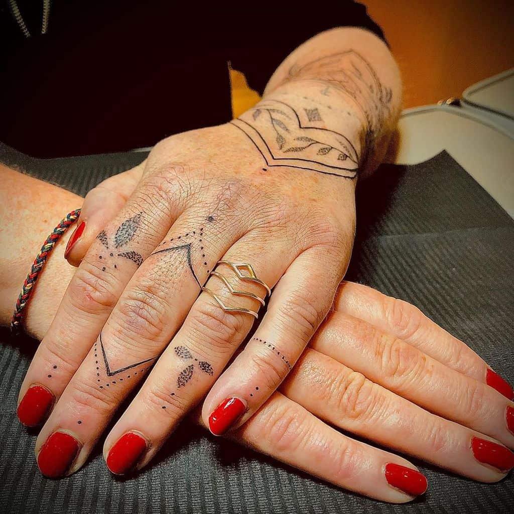 Small Mandala Ornament Finger Tattoos ladystattoorostock