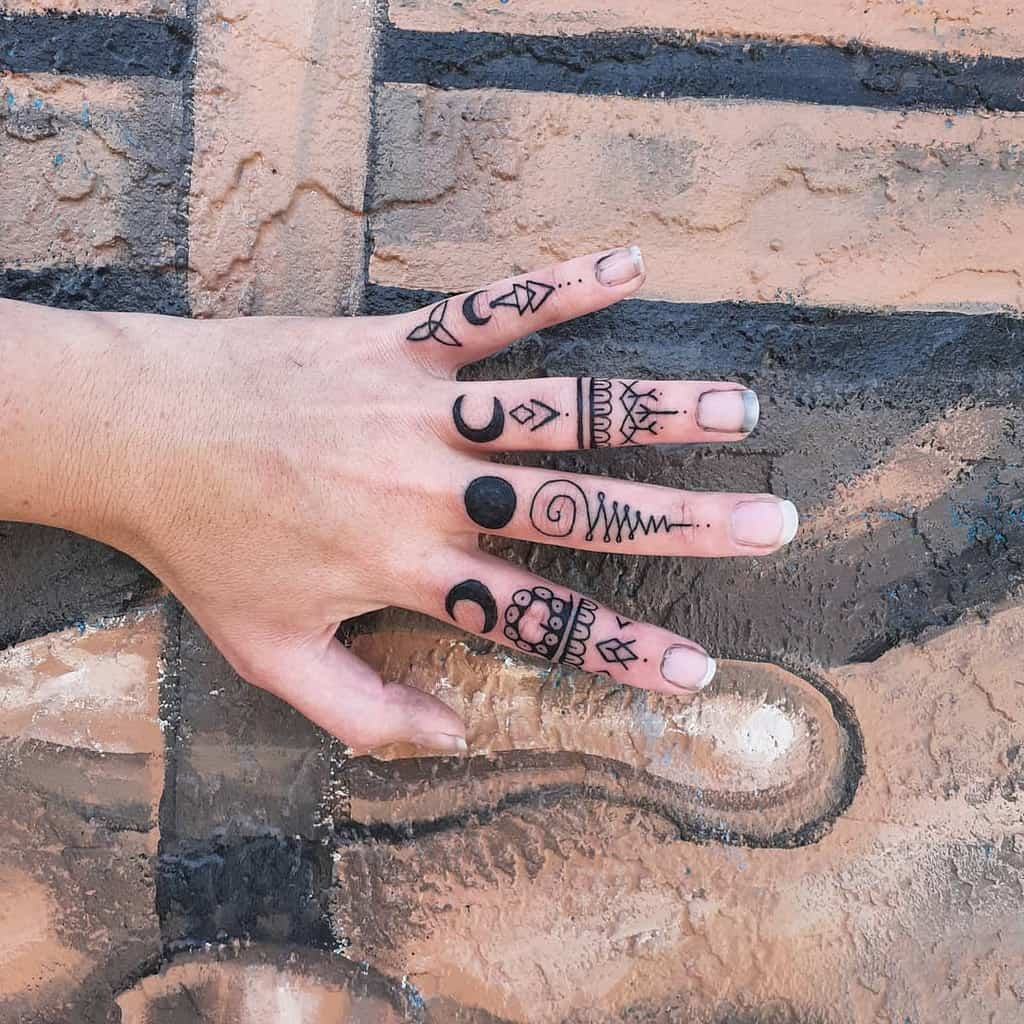 Small Mandala Ornament Finger Tattoos tcastrotattoos