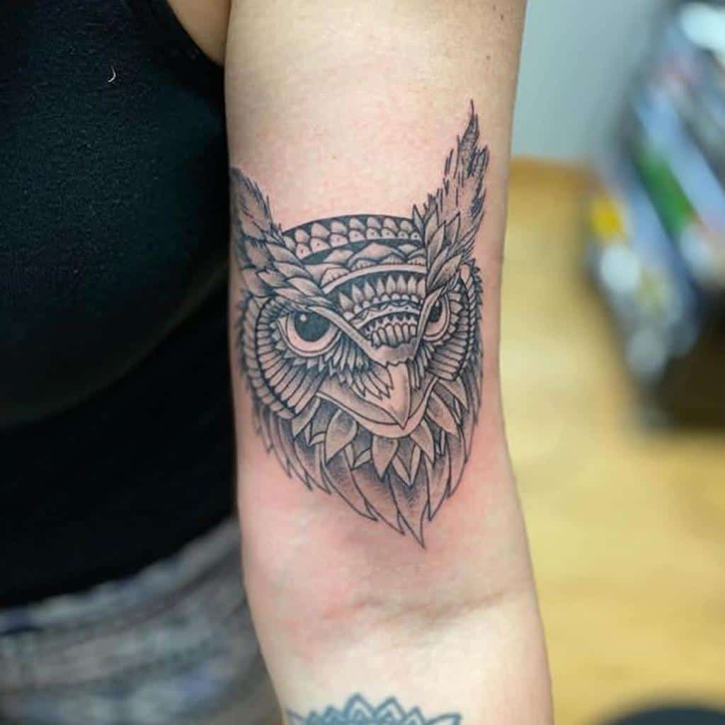 Small Owl Upperarm Tattoos lotus_drops