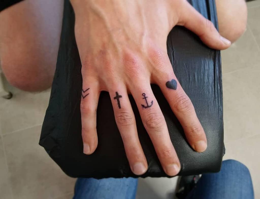 Small Symbol Finger Tattoos sam.r_tattoo