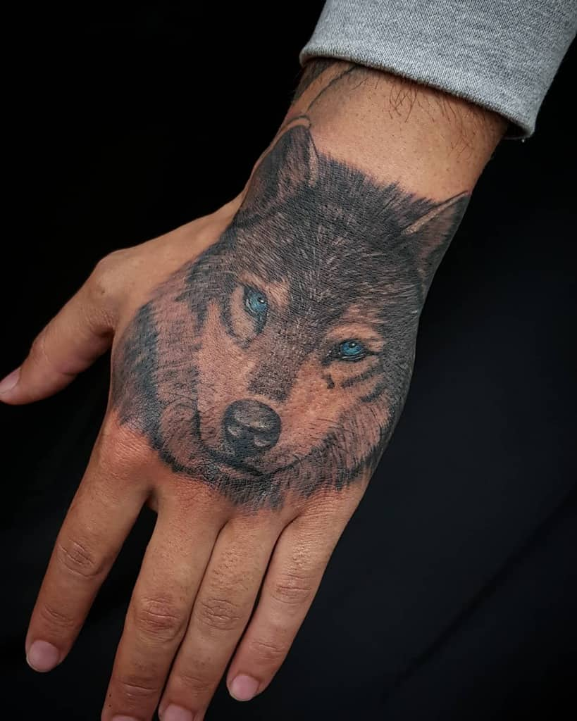 Small Wolf Hand Finger Tattoo tattooer_jije