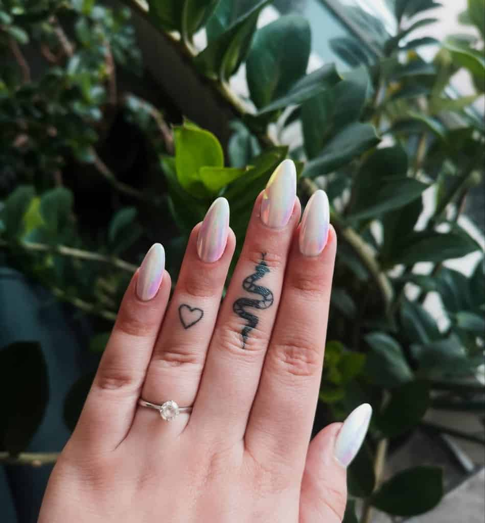 Small Women Finger Tattoos silvervalkyrie_