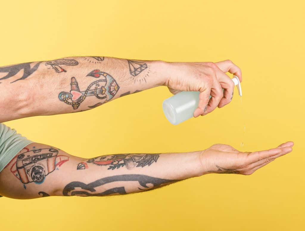 Tattooed Arms With Antibacterial Soap