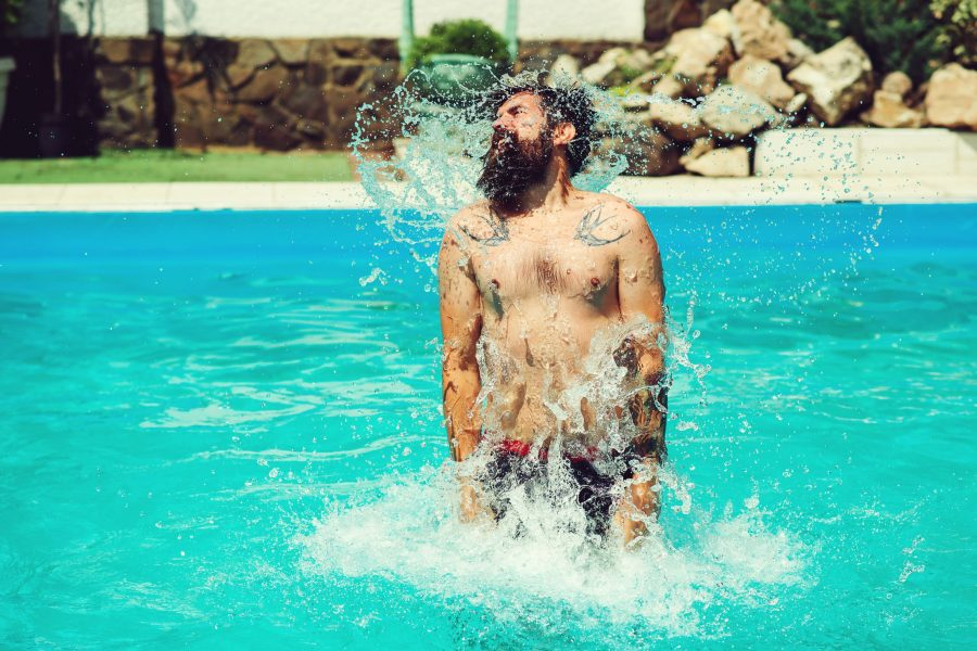 Tattooed And Bearded Man In Pool