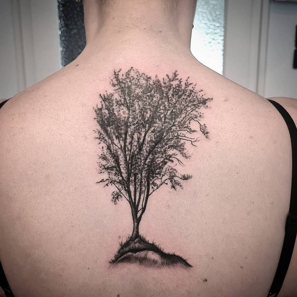Tree Silhouette Back Tattoo inkland.tattoo