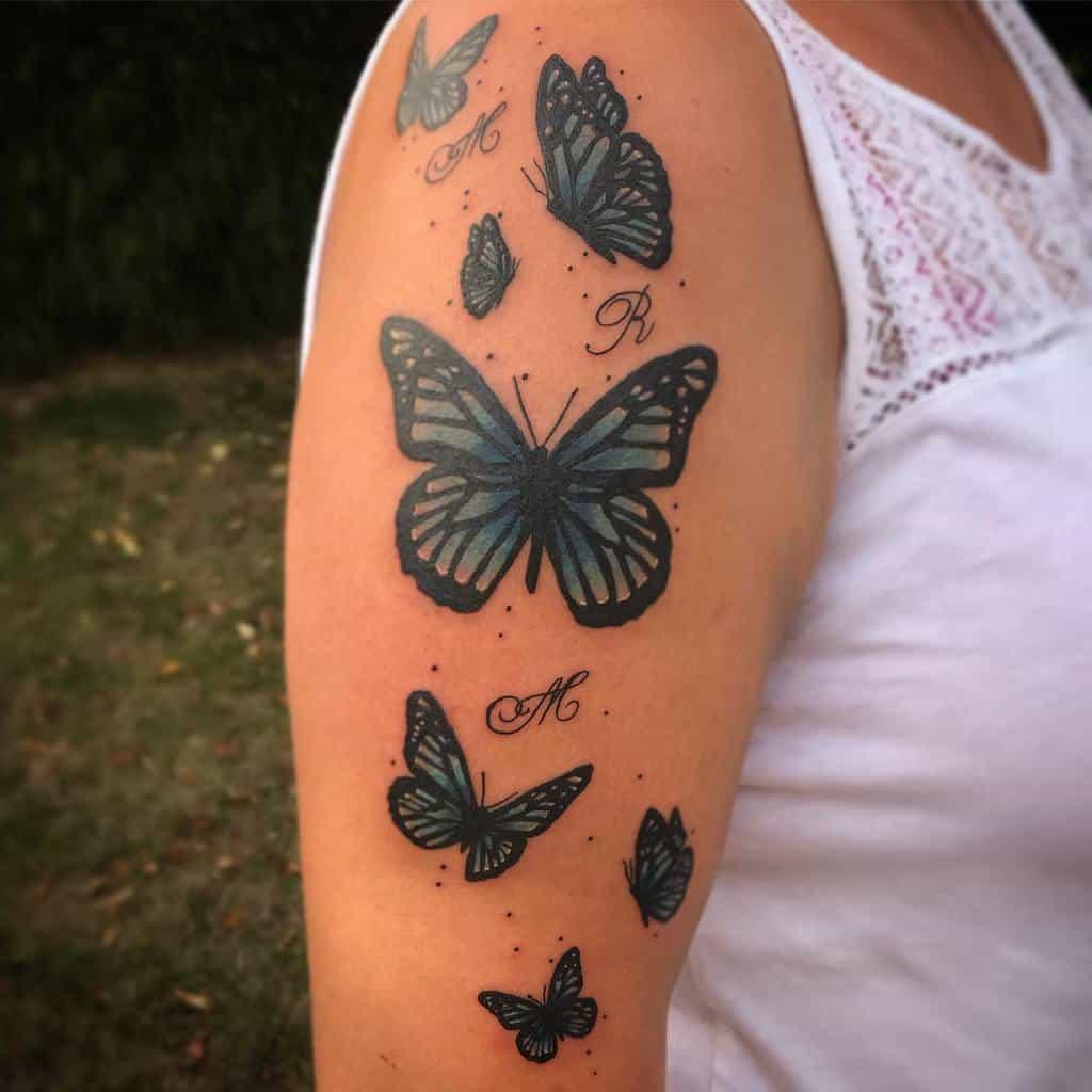 Upperarm Blue Butterfly Tattoos sophstattoo