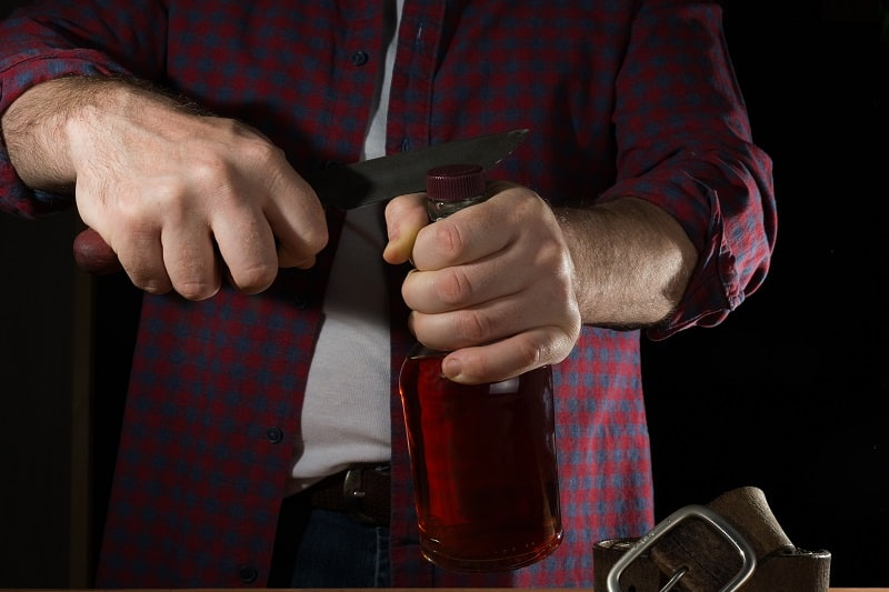 Use-a-Pocket-Knife-to-Open-a-Bottle