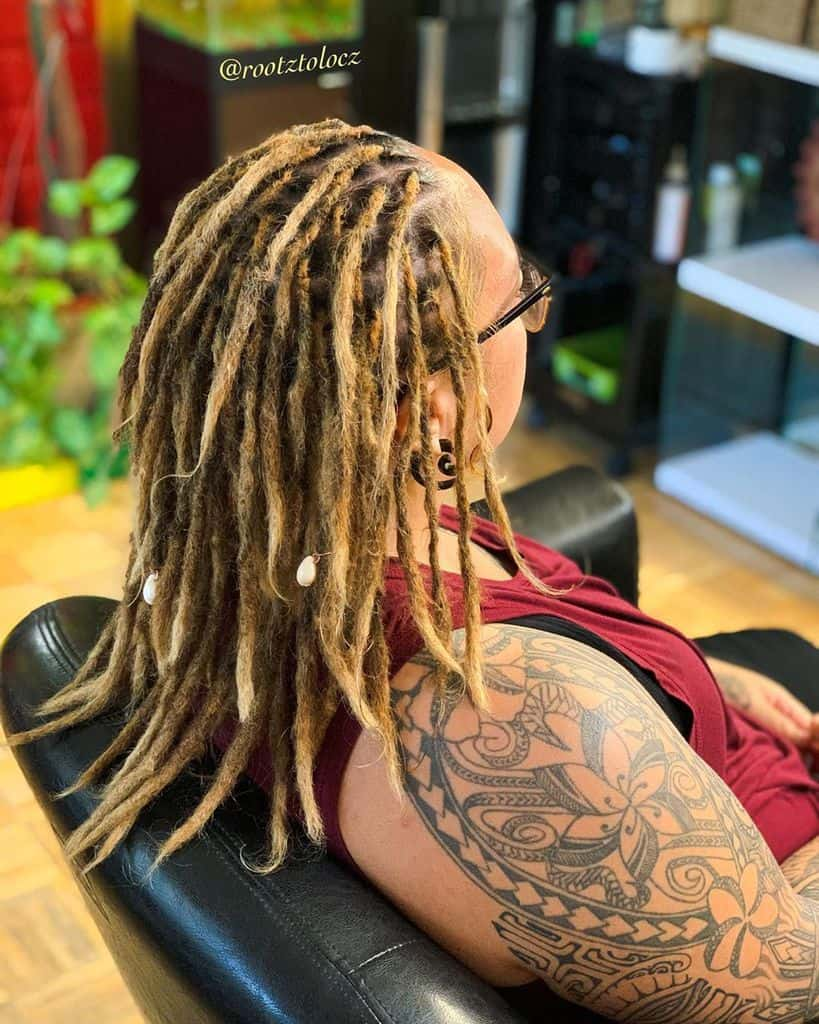 Woman With Dreadlock Hairstyle Featuring Medium Length Dreads