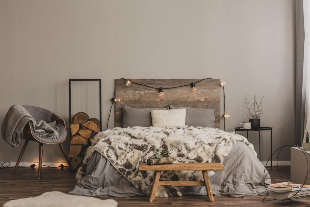 Stylish,Grey,Chair,With,Blanket,And,Log,Of,Wood,Next