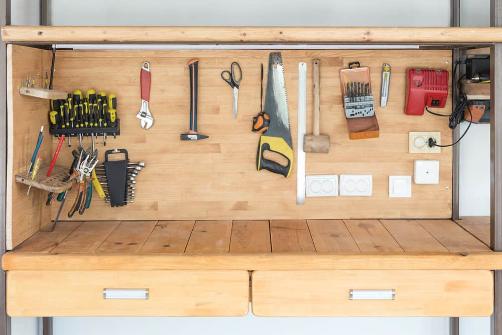 Wooden,Workbench,At,Workshop.,Lot,Of,Different,Tools,For,Diy
