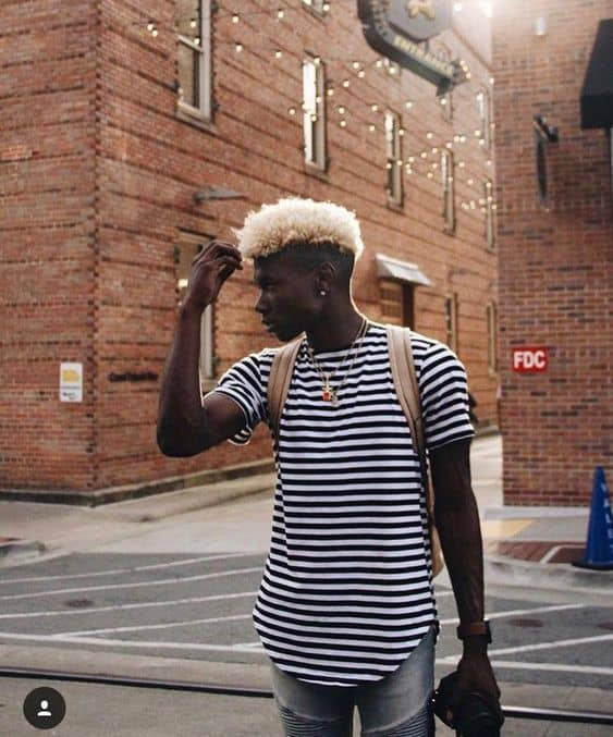 An afro Mohawk hairstyle with platinum blonde hair
