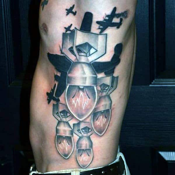 Abstract Light Bulb Airplane Bomber Tattoo On Ribs