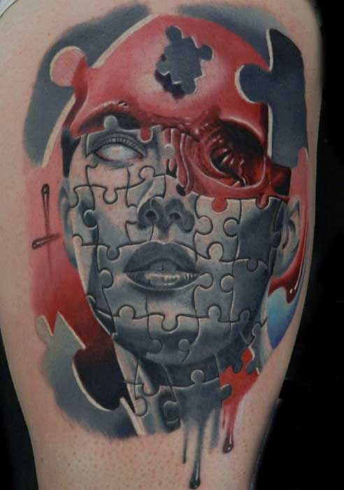 Abstract Mens Thigh Puzzle Piece Tattoo In Blue And Red Ink