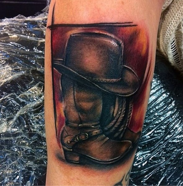 Abstract Watercolor Cowboy Boots And Hat Trash Polka Tattoo On Guy