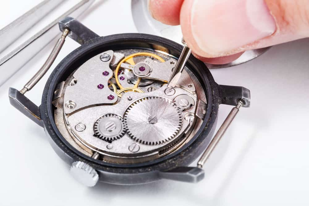 close up of adjusting old mechanic wristwatch