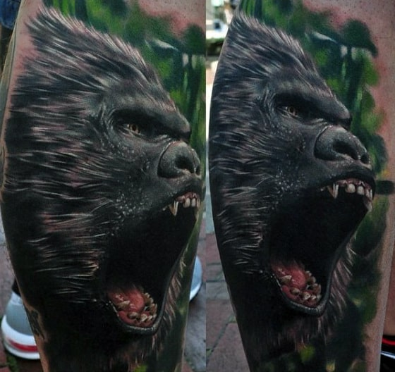 Agressive 3d Guys Gorilla Tattoo With Green Forest Background