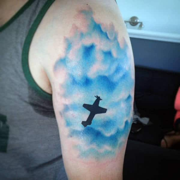 Aireplant Flying Through Blue Cloud Mens Tattoos Designs On Arm