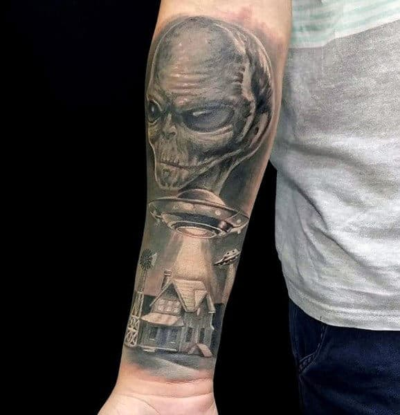 Alien With Spacecraft And House Mens Forearm Tattoo
