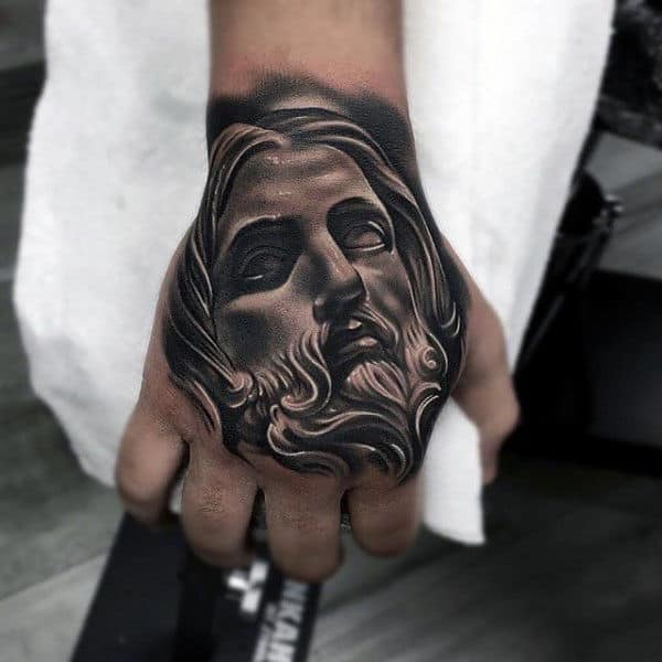 Amazing 3d Male Hand Tattoo Of Jesus Christ Face