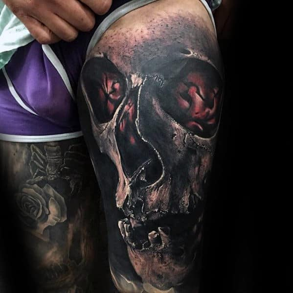 Amazing 3d Skull With Glowing Red Design Tattoo For Men On Thigh
