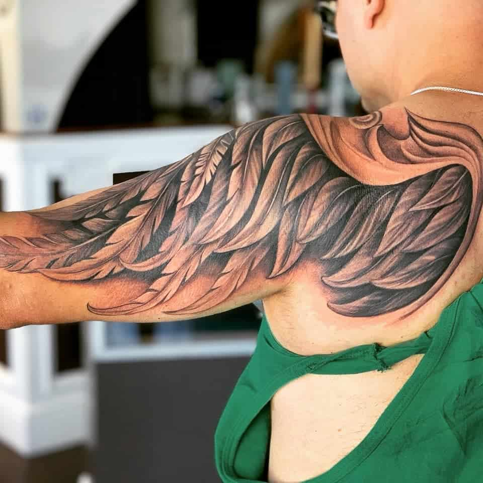 Amazing artwork inked angel wing shoulder tattoo