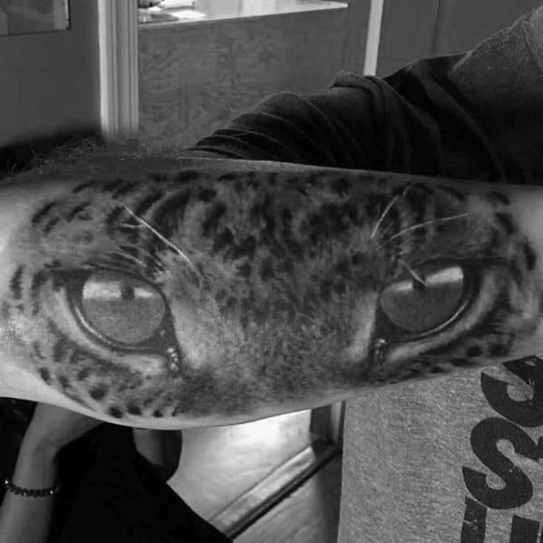 Amazing Cheetah Eyes Male Outer Forearm Tattoos
