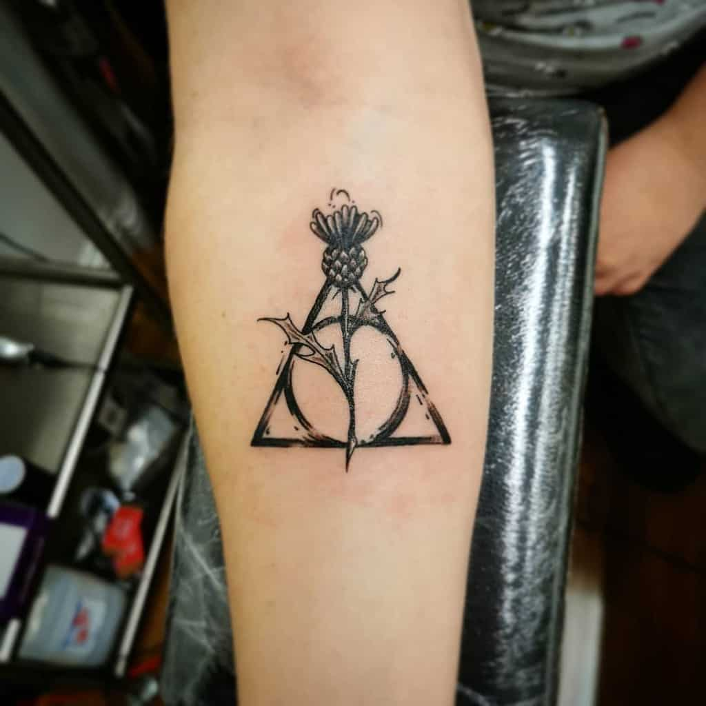 amazing deathly hallows tattoo on arm